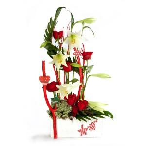 bouquets de noël: compositon de Noël en fleurs rouges et blanches
